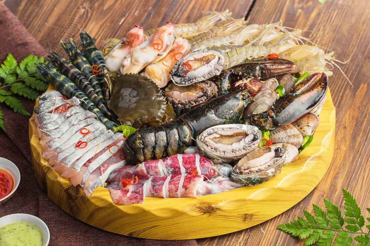 thịt bò kỵ với hải sản